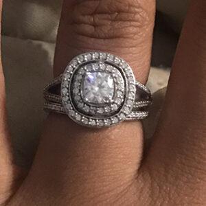 Custom moissanite and diamond halo ring