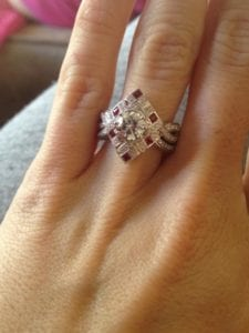 Nikki showing off her ruby and diamond ring.